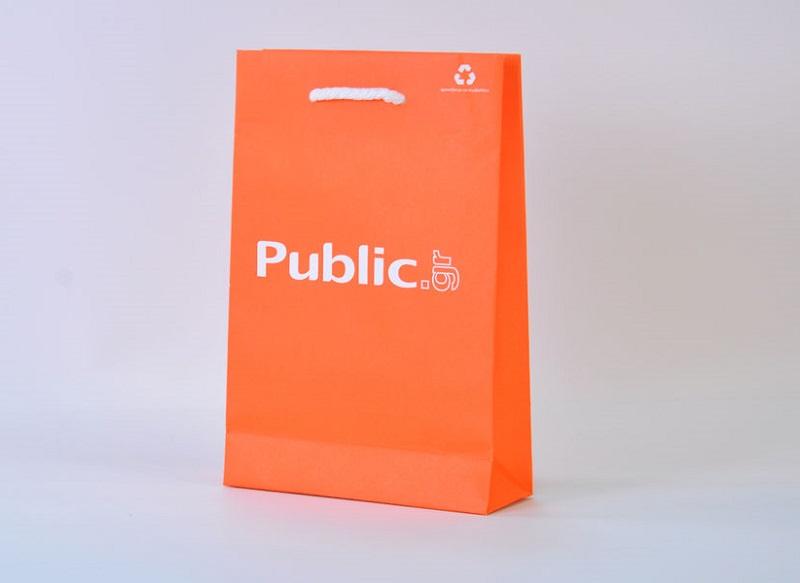 mẫu túi giấy couche màu cam đơn giản